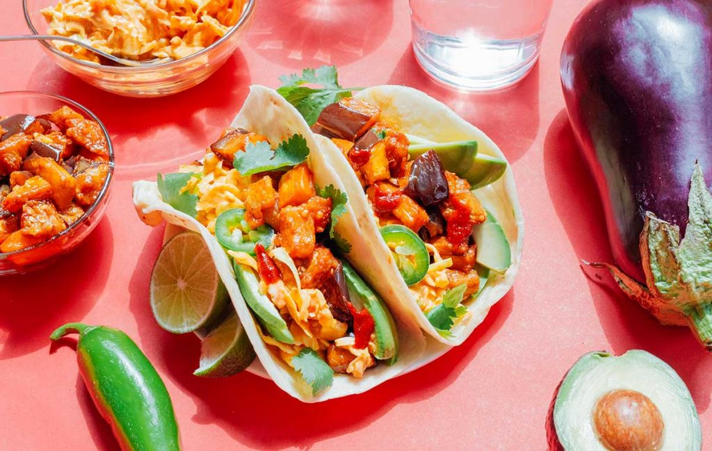 Korean eggplant tacos on a red background