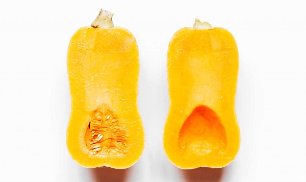 Two halves of a butternut squash facing up