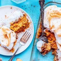 Sweet potato casserole with meringue on a blue background