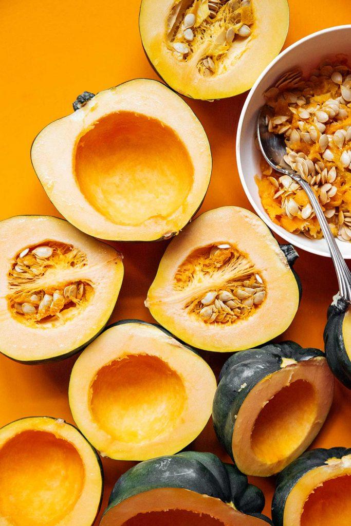 Deseeding acorn squash halves