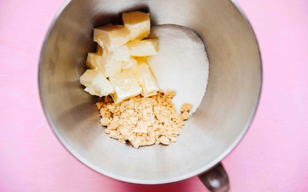 Butter, white sugar, and light brown sugar in a metal mixing bowl