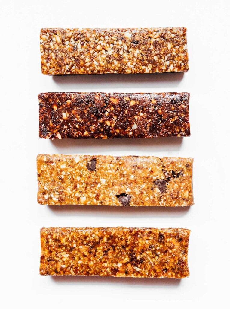 Homemade larabars on a white background