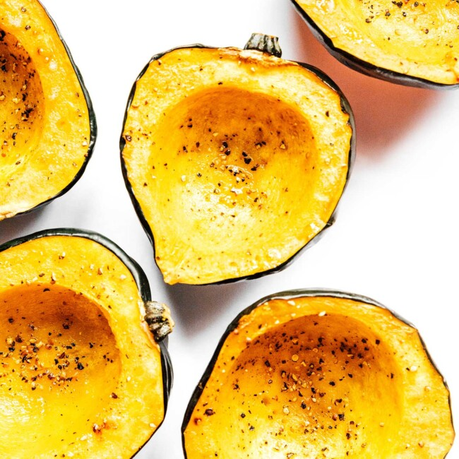 Roasted acorn squash on a white background