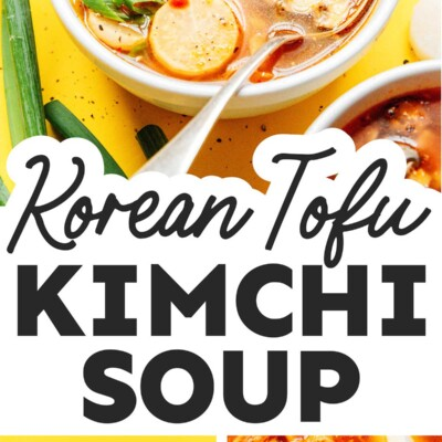 Kimchi soup in a bowl with a spoon on a yellow background