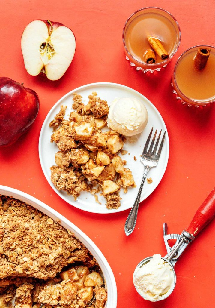 A plate filled with vegan apple crisp and a scoop of ice cream