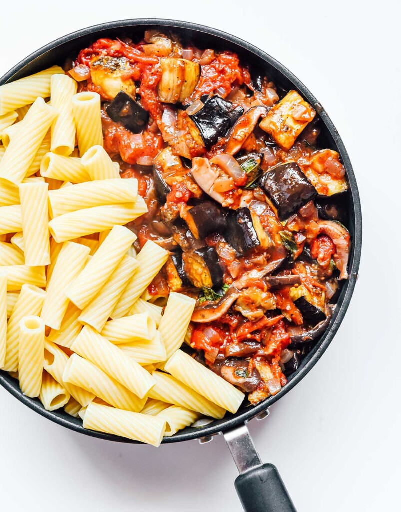 A skillet filled with vegetable bolognese sauce and rigatoni noodles