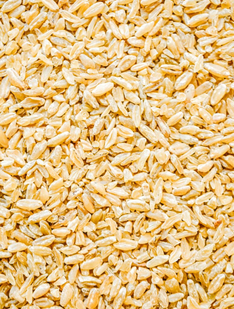 A close-up photo of uncooked freekeh that displays the grains' texture