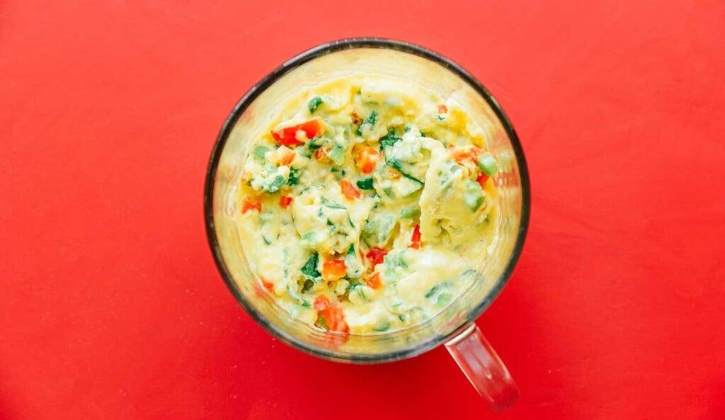 A cooked veggie mug omelette