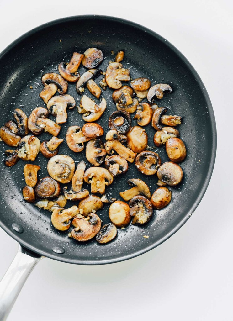 Sautéed sliced mushrooms in a skillet