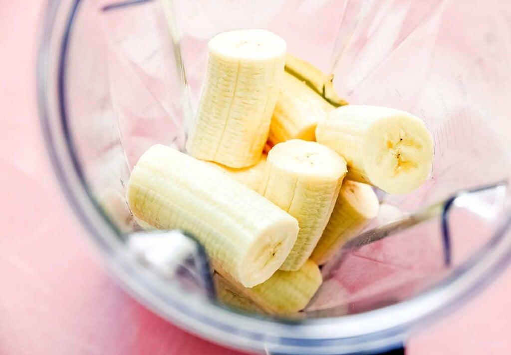 A blender filled with 8 banana halves