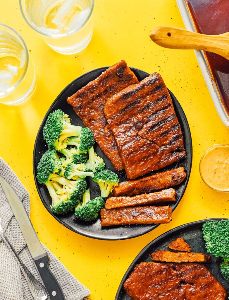 A plate filled with seitan steak patties and broccoli