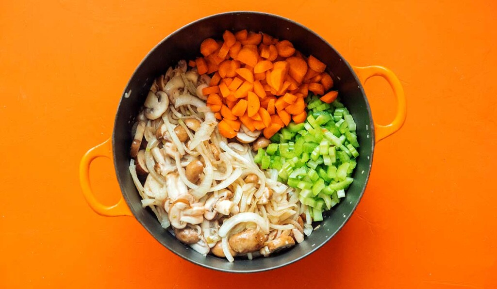 A large pot filled with chopped shepard's pie vegetables