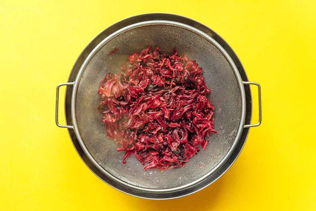 A strainer filled with boiled hibiscus pieces