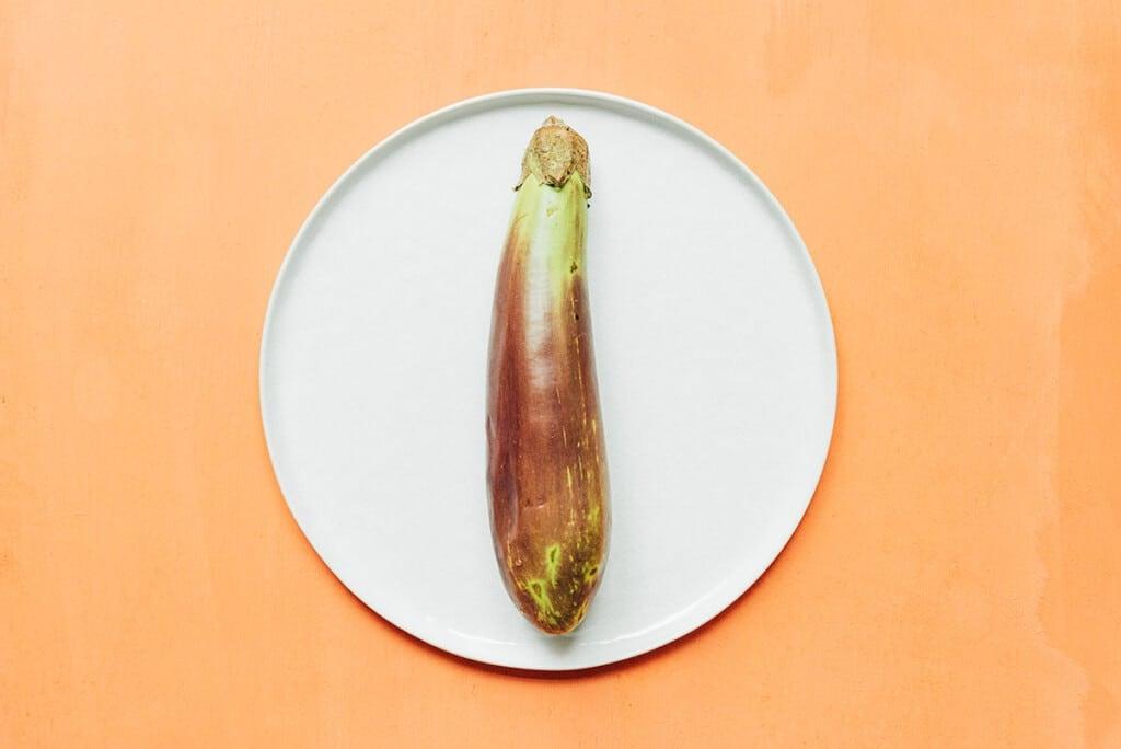 A Filipino eggplant on a white plate