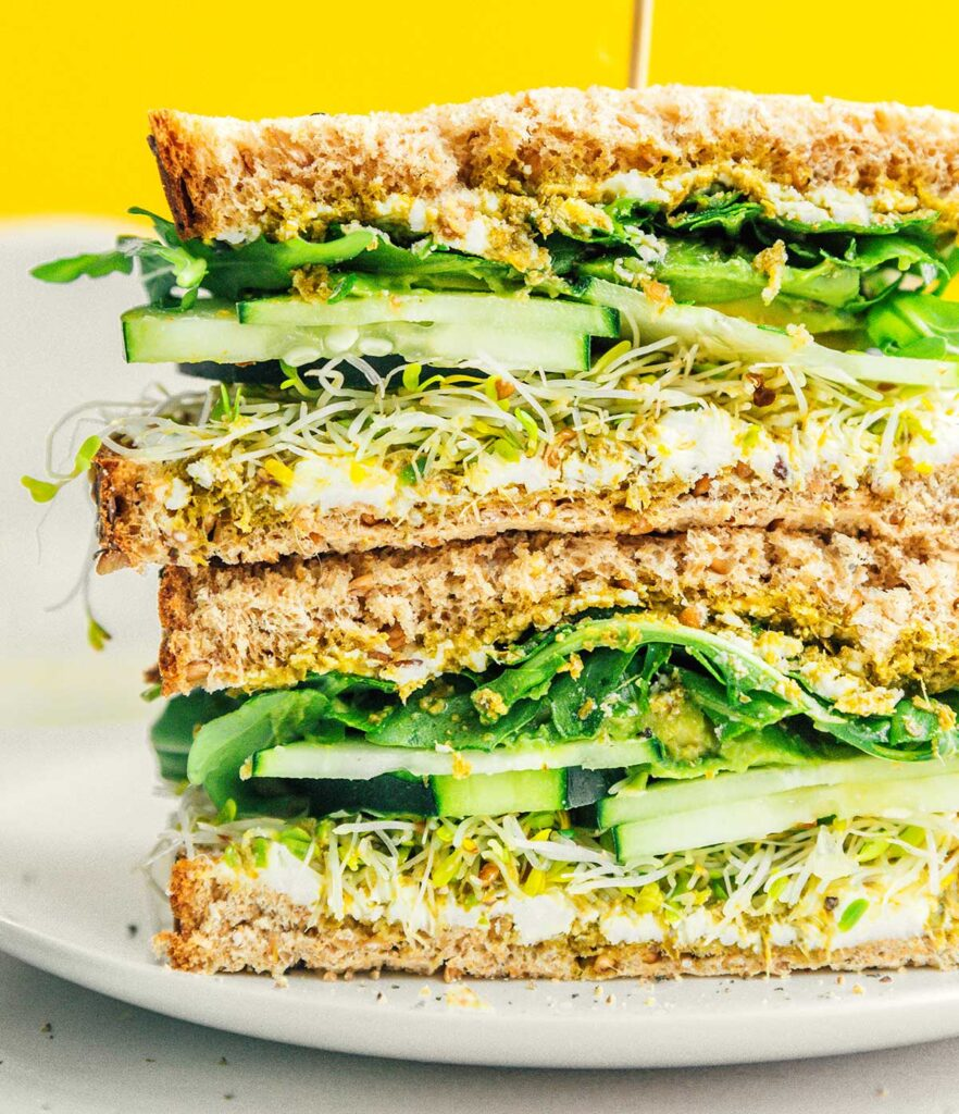A close up image detailing the texture and layers of the middle of an avocado sandwich