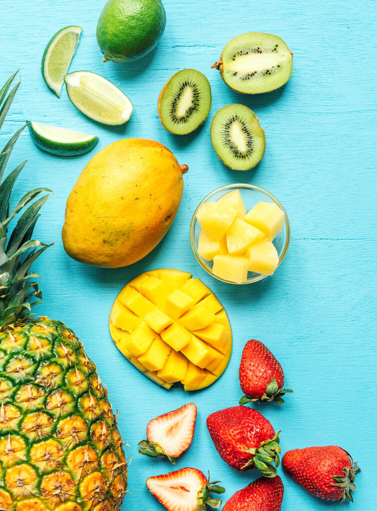 Assorted fruit on a blue background