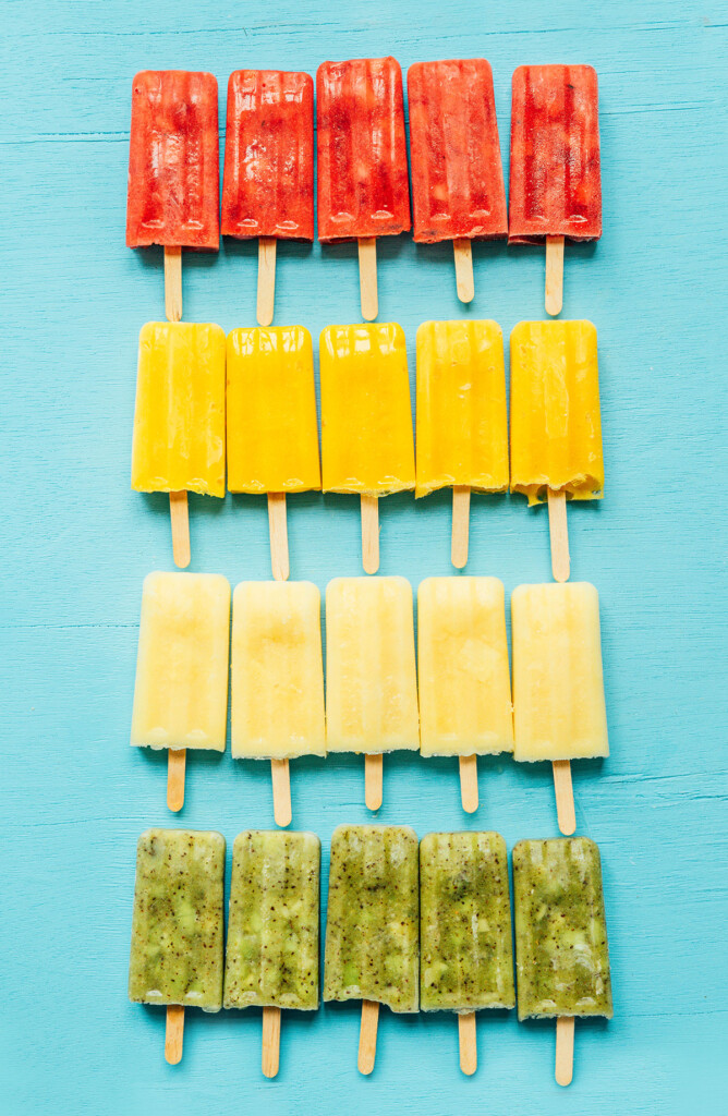 Multicolored Mexican paletas on a blue background