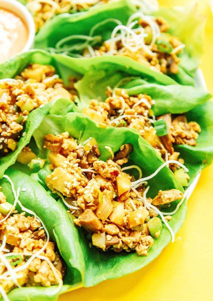 A close-up view detailing the filling in vegan lettuce wraps