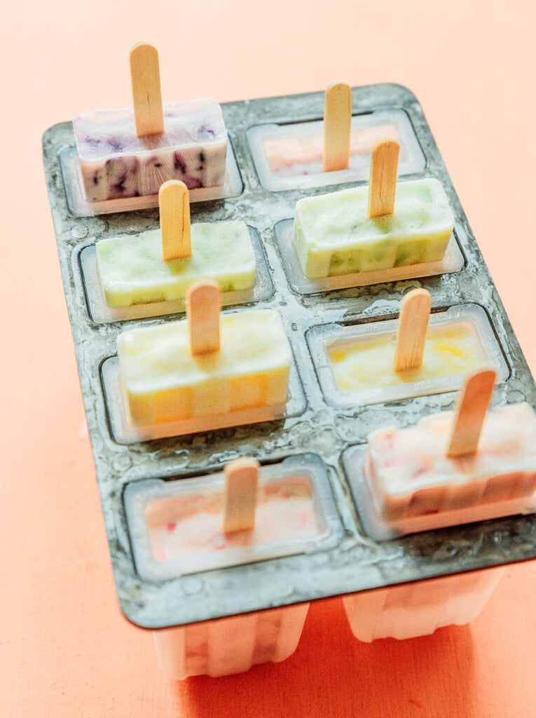 A popsicle mold filled with 8 frozen popsicles