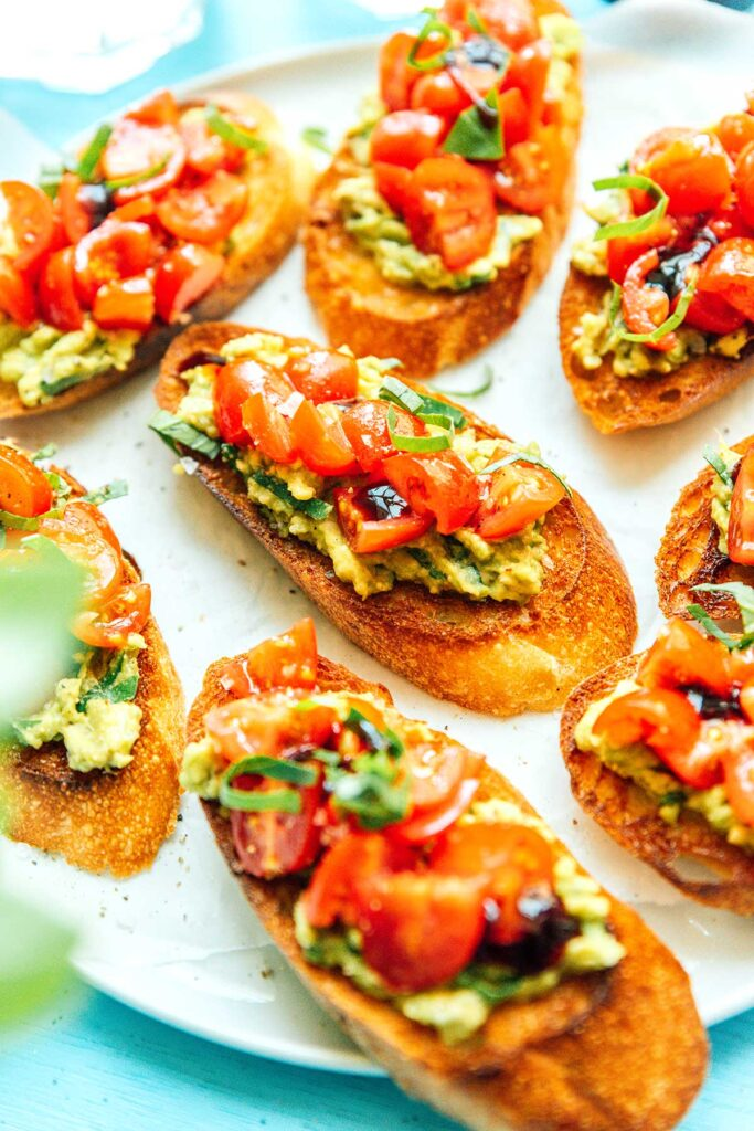 A close up view detailing the texture of avocado bruschetta
