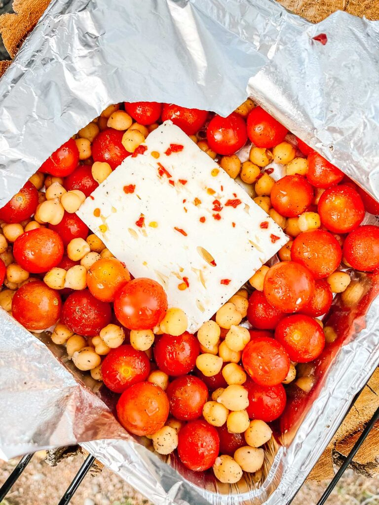 A freshly cooked tray of tomato feta bake with chickpeas