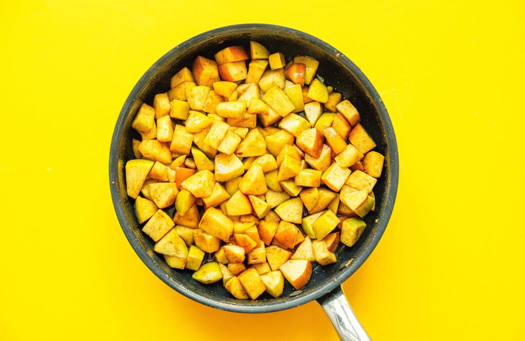 A sauté pan filled with freshly stewed apples